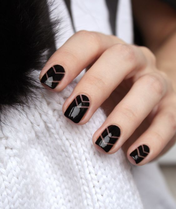 black chevron nails with negative spaces