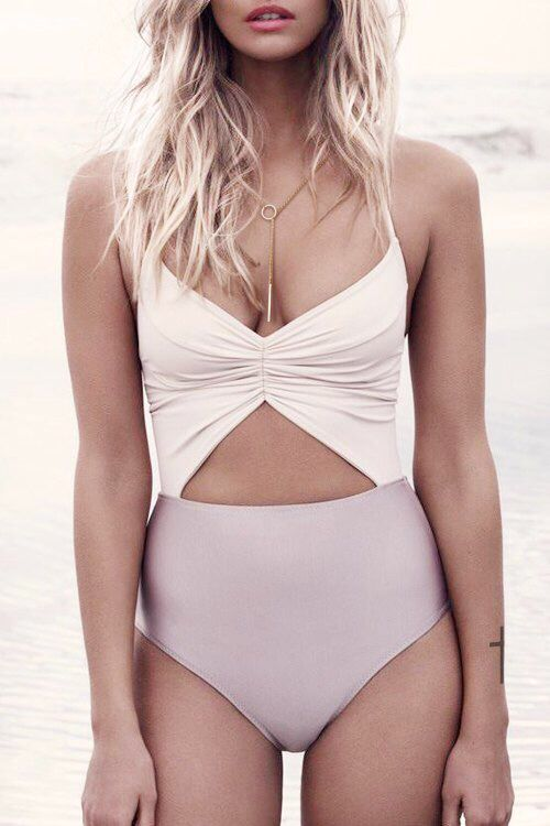 blush and mauve ruched one piece with spaghetti straps and a triangle cutout