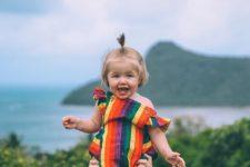 04 bold rainbow baby romper with ruffled cap sleeves