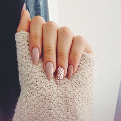 nude nails and a pink glitter accent one - 20 Chic Nail Art Ideas For Almond Shape - Styleoholic