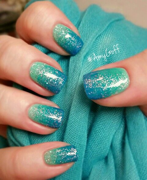 ombre mermaid-inspired nails from light green to bold blue