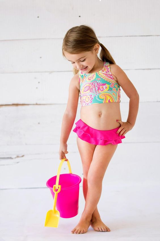 colorful printed top and fuchsia bottom with a ruffled skirt