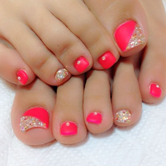 coral red nails and accent gold glitter halves