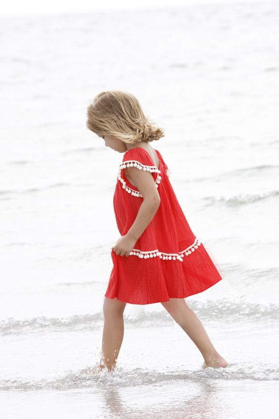 light red dress with white pompom trim is very comfy for wearing