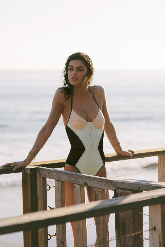 one-piece color block wimsuit in black, green and pink with thin straps