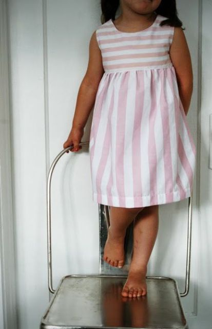 Picture Of Pink Vertical And Horizontal Striped Dress