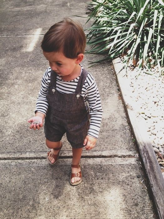 a striped longsleeve and a brown overall with shorts and sandals