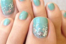 06 aqua-colored nails with silver sequins for a cool glam look