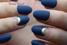 06 blue matte nails and half moon accent ones with a gold touch