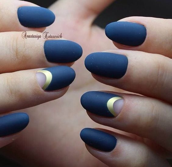 Picture Of blue matte nails and half moon accent ones with a gold touch