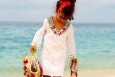 06 chic beach dress with long sleeves and embellishments as a beach cover up