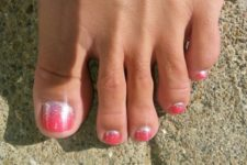 06 coral red nails with a touch of silver glitter