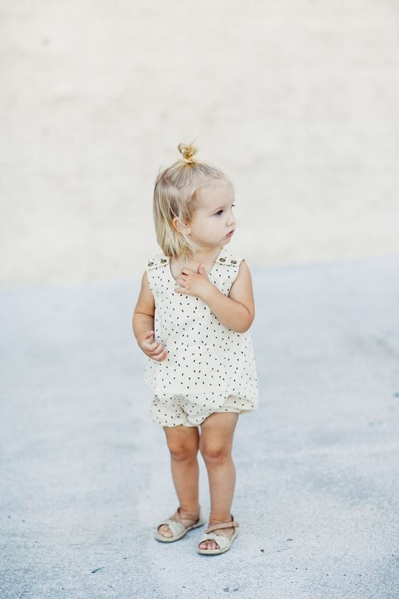 cute neutral printed romper with buttons on the shoulders