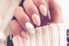06 nude nails and an accent white one with two thing gold stripes