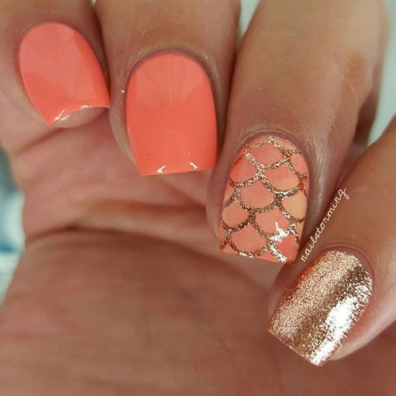 orange nails and an accent nail with fish scale gold glitter decor
