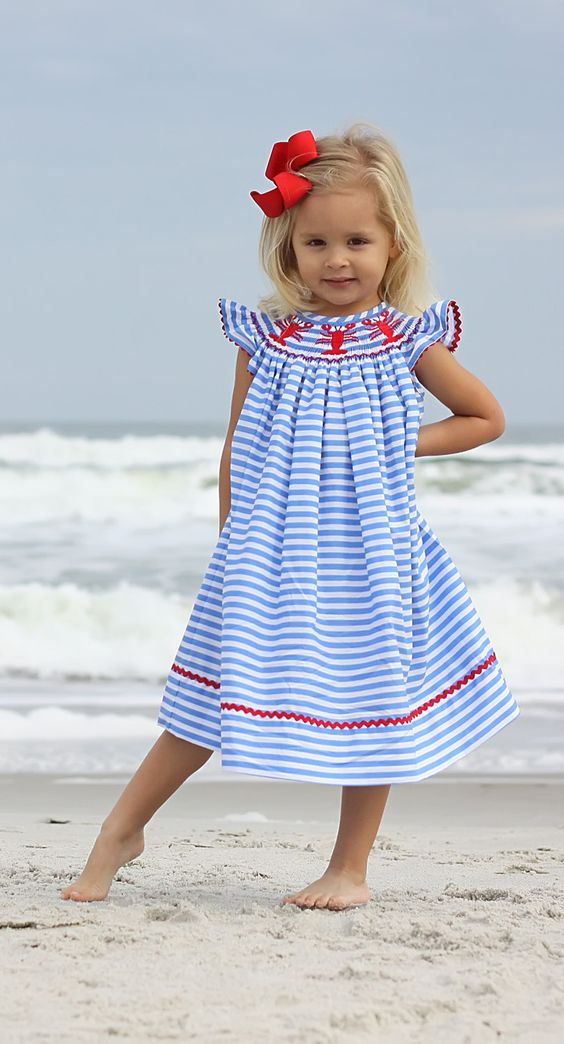 striped blue and white midi dress with lobster decor and ruffled sleeves