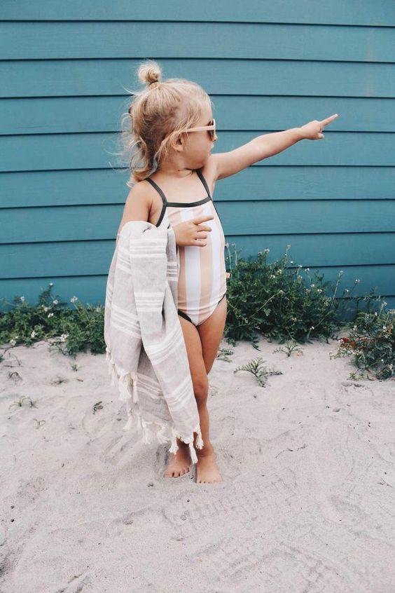 striped blush and white halter neckline swimsuit