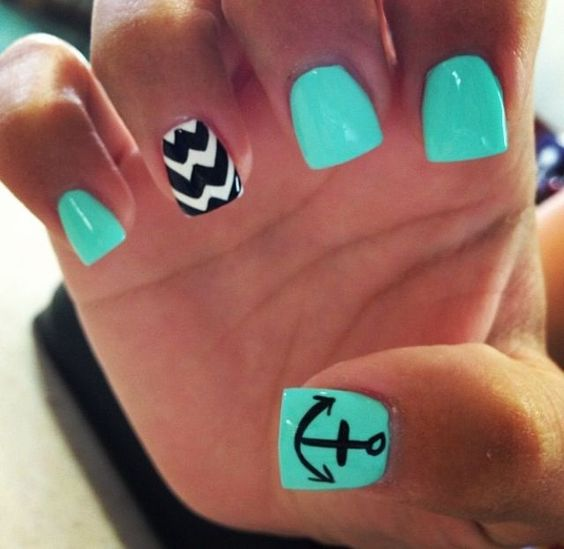 aqua nails and an accent chevron one in black and white