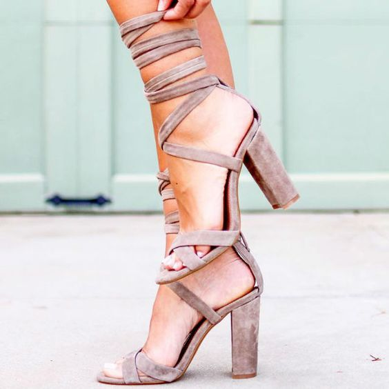 blush suede lace up heeled sandals with lacing over the ankle