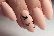 07 matte pink nails with an accent black bird nail