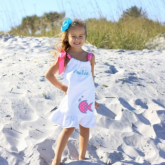 white shoulder tie beach cover up with a fish applique