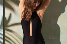 08 chic black one piece bathing suit with a halter neckline and a vertical front cutout