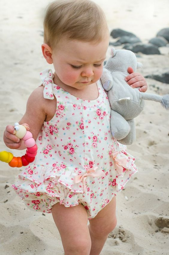 cute vintage-inspired pink rose printed romper with ruffles