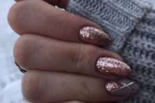 08 rose glitter nails with an accent one with geo stripes