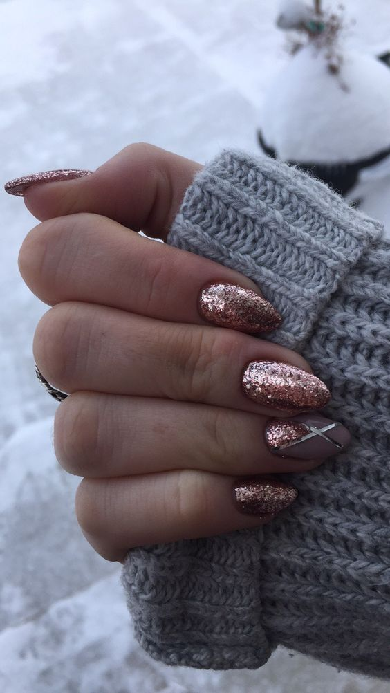 rose glitter nails with an accent one with geo stripes