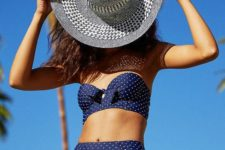 09 a navy and white polka dot swsimsuit with a bow bandeau top and a high waist bottom