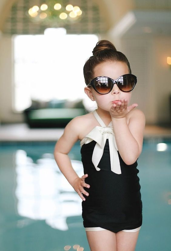 chanel inspired black and white bathing suit with a white bow on top