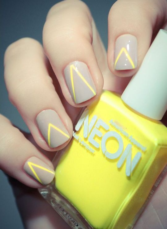 grey nails with neon yellow stripes for a chic look