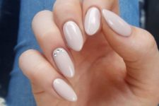 09 nude nails with an accent rhinestone one