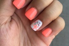 09 orange nails and an accent one with rhinestones and a starfish
