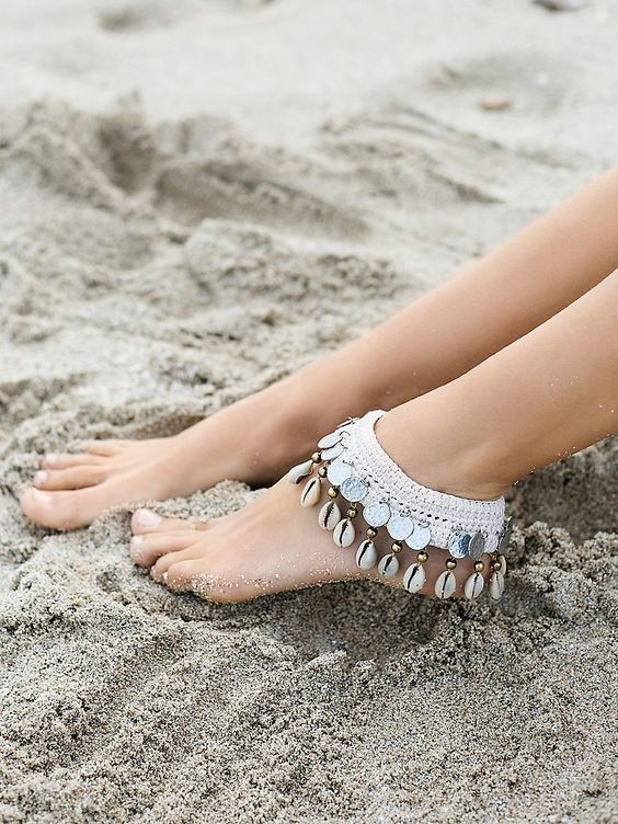 white crochet anklet with coins, shells and beads