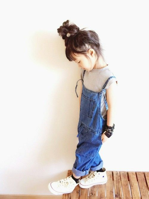 a grey tee, a denim overall and white Converse