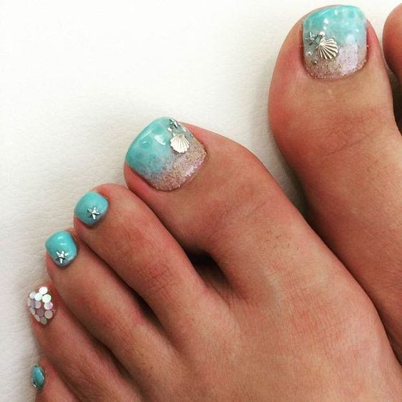 aqua-colored nails with silver starfish and shell accents