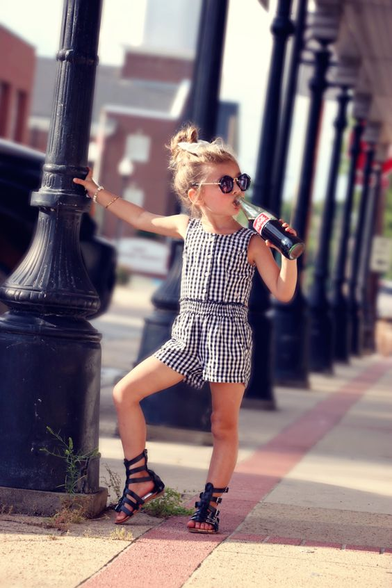 black and white gingham sleeveless romper and gladiator sandals