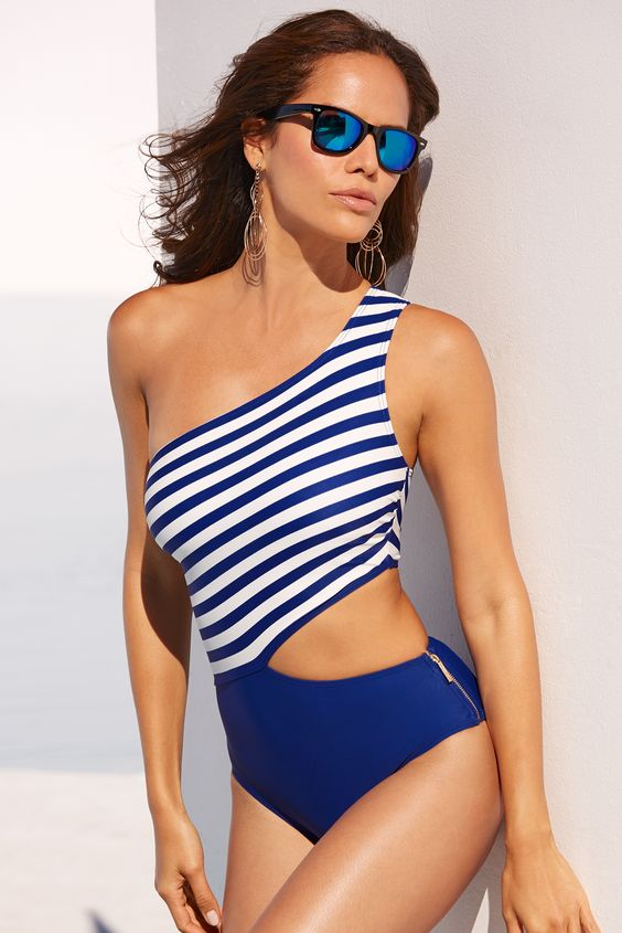 blue and white one piece swimsuit striped top and a solid bottom