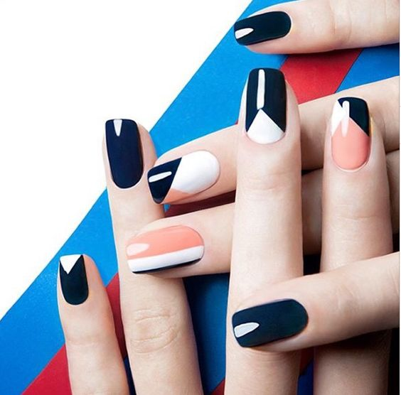 navy, orange and white graphic nails to rock