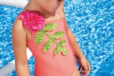 10 pink one shoulder bathing suit with a fabric flower and leaves
