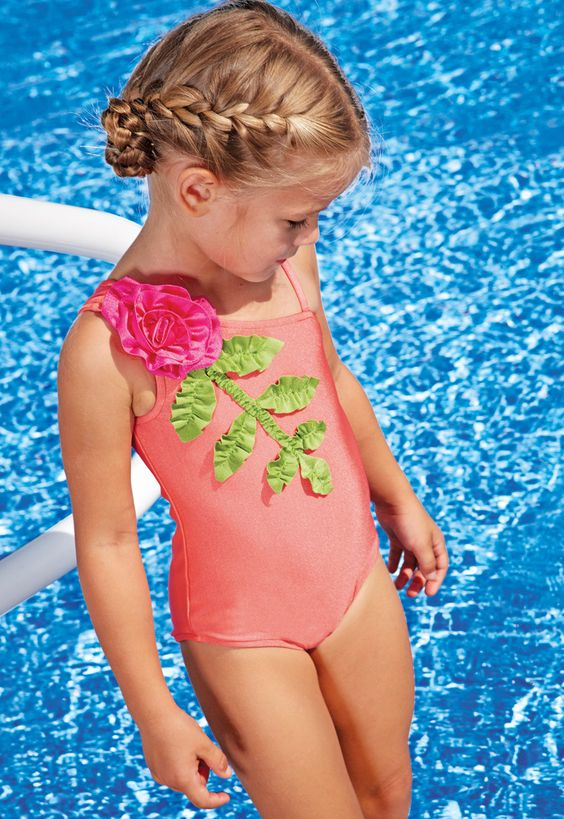 pink one shoulder bathing suit with a fabric flower and leaves