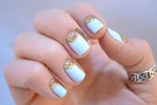 10 powder blue nails with gold glitter half moon detailing