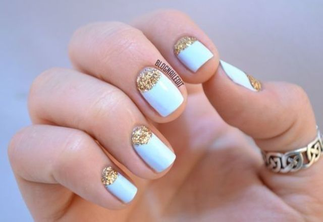 powder blue nails with gold glitter half moon detailing