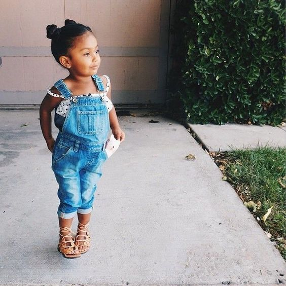 a polka dot straptop and a denim overall, lace up flats