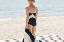 11 black and white geometric swimsuit and a matching cover up
