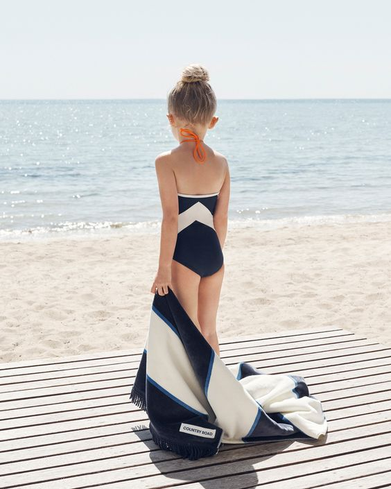black and white geometric swimsuit and a matching cover up