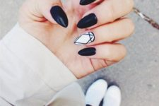 11 black nails and an accent white geo accent nail