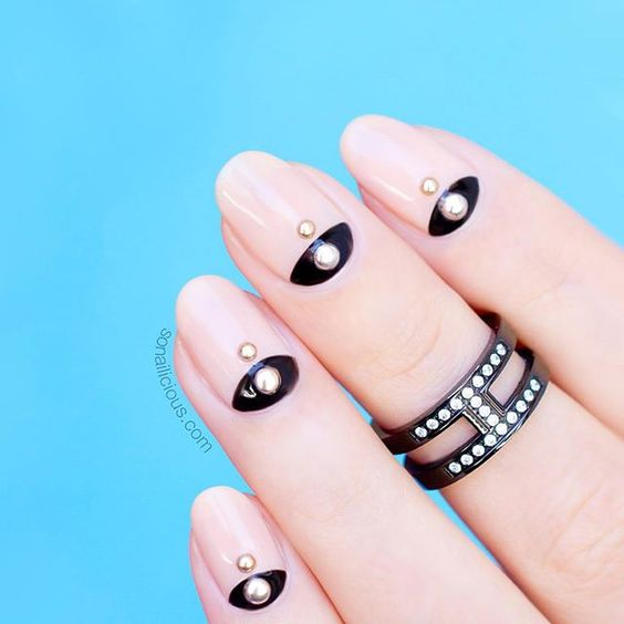 chic pink nails with black details and pearls and beads for a special occasion