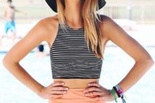 12 a two piece swimsuit with a peachy high waist bottom and a striped halter top
